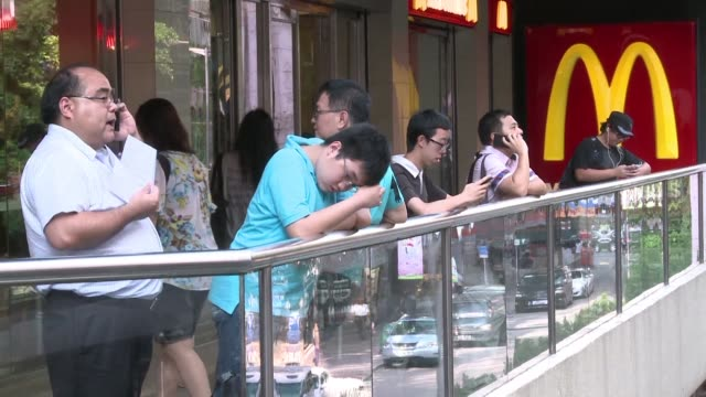 us fast food giant mcdonald's is to sell its mainland china and hong kong franchise business to a consortium of citic group and the carlyle group for... - mcdonald's stock videos and b-roll footage