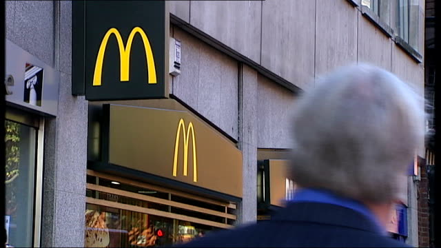 general views england london ext general views of fast food chain outlets including mcdonald's with pedestrians along and past / burger king... - chain stock videos and b-roll footage