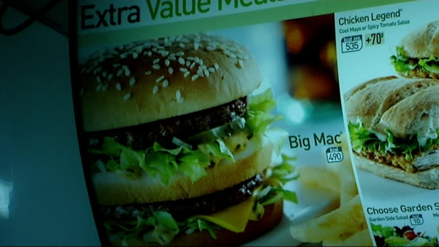 Fast food outlets to add calorie information to menus ENGLAND Lonond INT Good shots of customers waiting to buy fast food at a McDonalds burger...