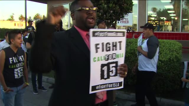 Fast Food Workers Protest for Higher Wages Outside a McDonald's Restaurant