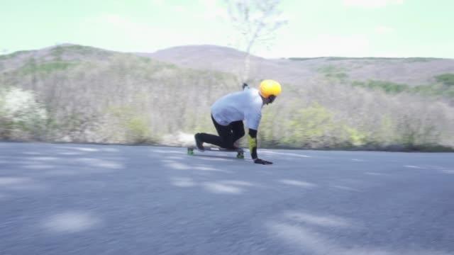 fast longboarding downhill - longboarding stock videos & royalty-free footage