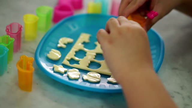fast motion child with cheese mould cutting - plate stock videos & royalty-free footage