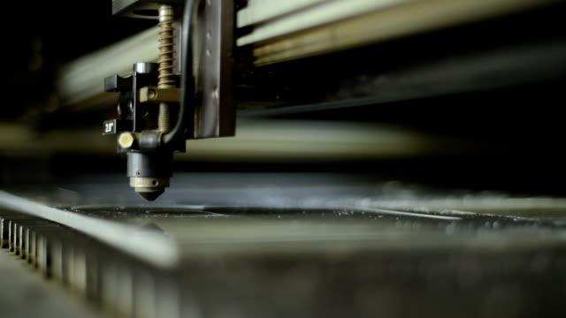 Fast motion close-up shot of a laser cutting machine