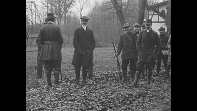 men in the hunting party walking forward wilhelm speaks / the men standing behind a blind firing quickly as the guns are handed off reloaded and... - fast motion stock videos & royalty-free footage