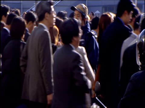 fast motion montage of people crossing roads, tokyo - identità video stock e b–roll