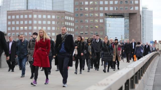Fast motion of commuters walking over London Bridge next to the Shard towards the City of London UK on Tuesday Nov 7 Photographer Luke...
