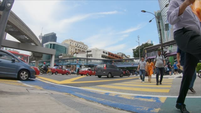 fast motion pedestrian traffic at a busy intersection - malaysia stock videos & royalty-free footage