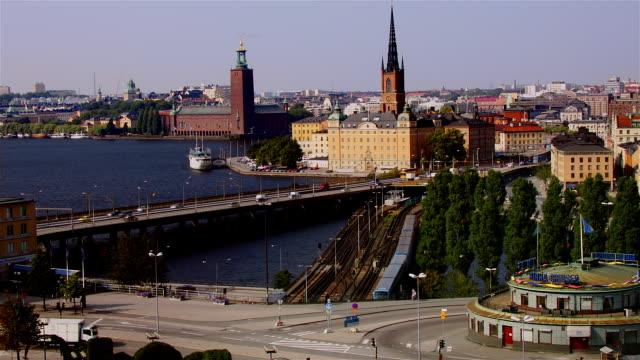 fast motion shot from sodermalm of gamla stan and traffic passing over bridge / stockholm, sweden - famous place stock videos & royalty-free footage