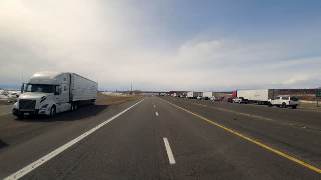 fast motion time-lapse of i40 traffic jam and car transporter on the move in arizona area on march 25, 2021 - fast motion stock videos & royalty-free footage