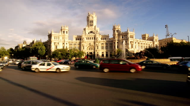 fast motion traffic passing plaza de cibeles at junction of paseo del prado and calle de alcala in madrid, spain - paseo del prado madrid stock videos and b-roll footage