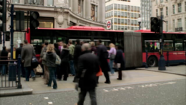 fast motion wide shot traffic and pedestrians at intersection in oxford circus/ london - following moving activity stock videos and b-roll footage