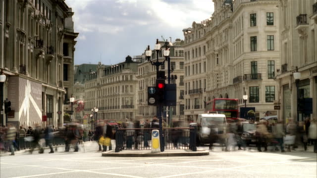 fast motion wide shot traffic and pedestrians at intersection/ london - following stock videos & royalty-free footage