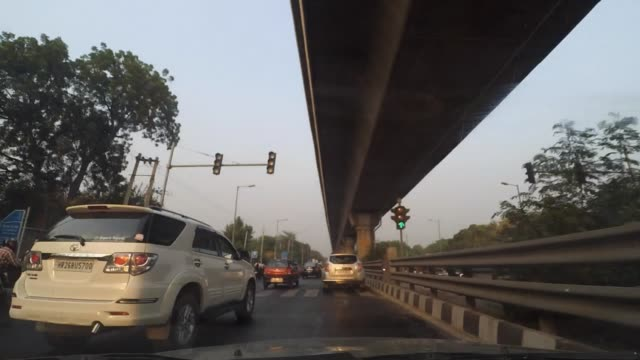Fast moving car's POV through the busy roads of New Delhi