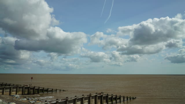 fast moving cloud time-lapse over the sea. - horizont stock-videos und b-roll-filmmaterial