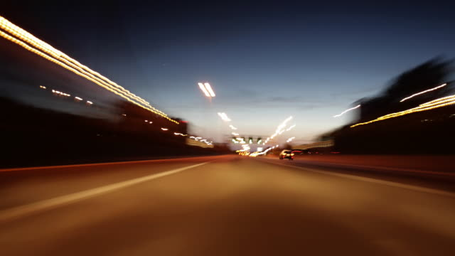 ws  fast moving traffic on motorway in night / antwerp,antwerp,belgium - multiple lane highway stock videos & royalty-free footage