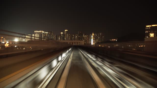 fast moving train at night - macao stock videos & royalty-free footage