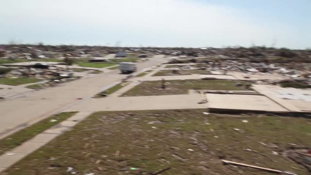 a fast pan of a wide area of destruction near the school destruction in moore oklahoma after ef5 tornado on may 22 2013 in moore oklahoma - oklahoma stock-videos und b-roll-filmmaterial