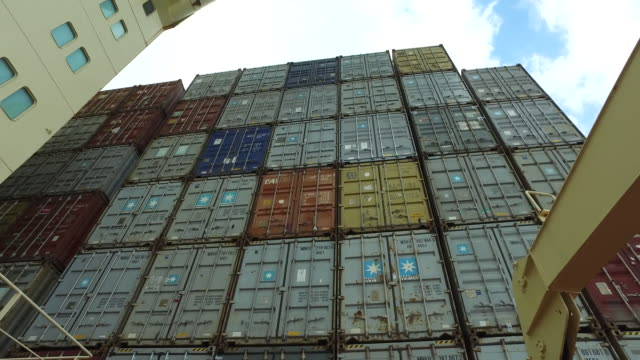 fast pan up stacked containers on-board a container ship at the port of felixstowe. - shipping stock videos & royalty-free footage