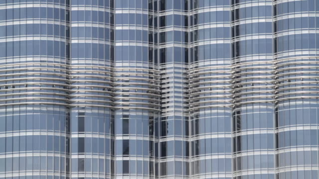 Fast pan up the exterior of the Burj Khalifa skyscraper in Dubai.