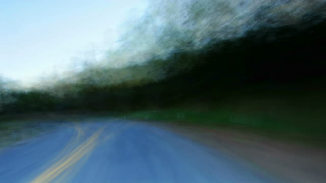 a fast ride down a country highway. - digital enhancement stock videos & royalty-free footage