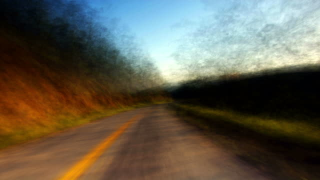 a fast ride down a country road. - digital enhancement stock videos & royalty-free footage