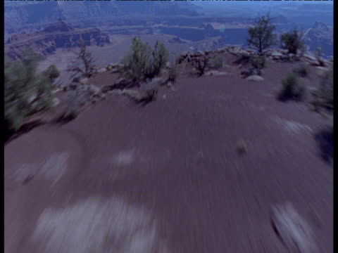 Fast track over cliff to reveal canyon in desert, Moab, Utah