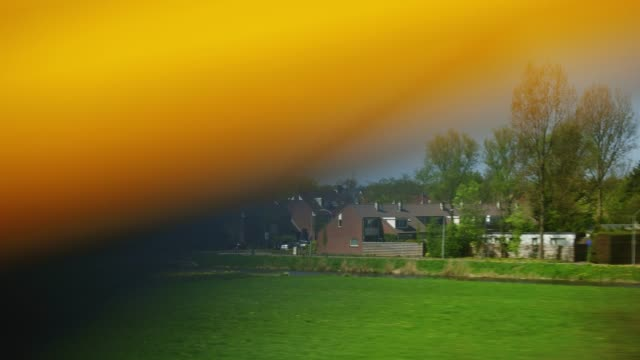 fast train passing tulips field around lisse in holland - rotterdam stock videos and b-roll footage