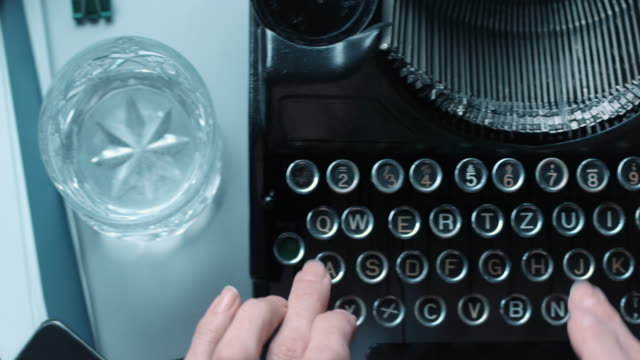 DS fast typewriting behind an old office desk