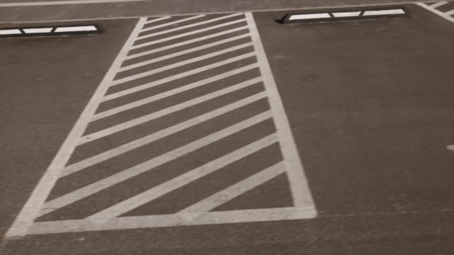 fast view on separated disabled signs on asphalt parking lots near shopping centre or mall - disability icon stock videos & royalty-free footage