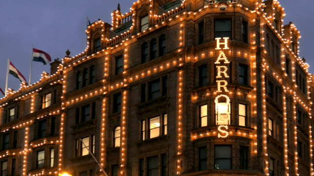 fast zoom out on the harrods sign, knightsbridge, london, uk - shop sign stock videos & royalty-free footage