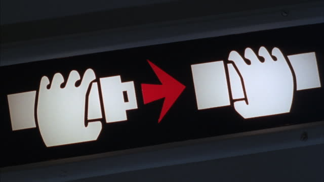 vídeos de stock e filmes b-roll de a fasten seat belt sign turns off and on and then shakes violently. - interior