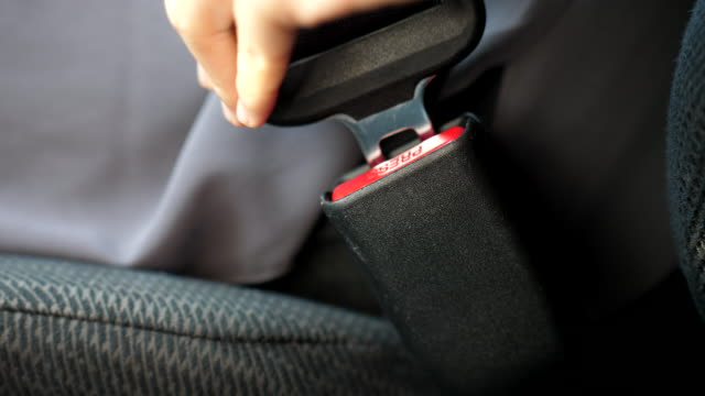 fastening car seat belt - seat belt stock videos & royalty-free footage
