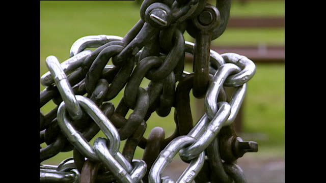 faster pan down tangled swing chains to padlock; 1993 - 1993 stock videos & royalty-free footage