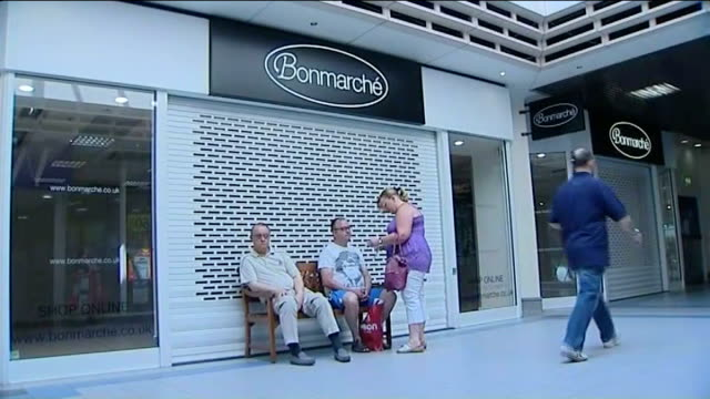 fastest fall in retail sales for 2 years; england: hampshire: havant: ext 'shop to let' sign tilt down shutters of closed shop front in town centre... - hand of cards stock videos & royalty-free footage