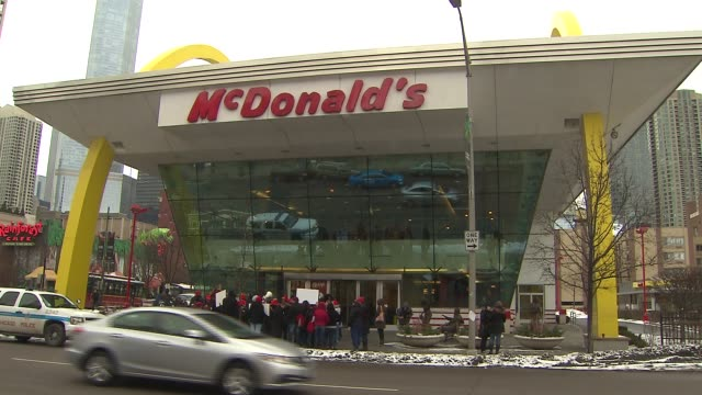 wgn fastfood workers expressed anger over the treatment of employees and protested on march 08 2014 in chicago illinois - mcdonald's stock-videos und b-roll-filmmaterial
