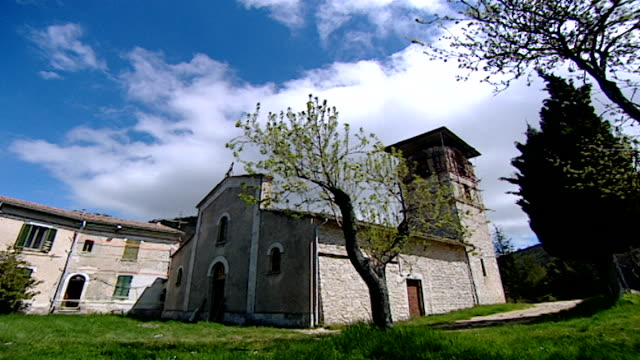 fast-motion view of the clouds moving over the medieval church of saint maron in volperino. during the crusades the relics of saint maron, founder of... - fast motion stock videos & royalty-free footage