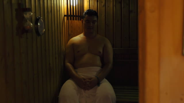 fat asian men in sauna - sauna stock videos and b-roll footage