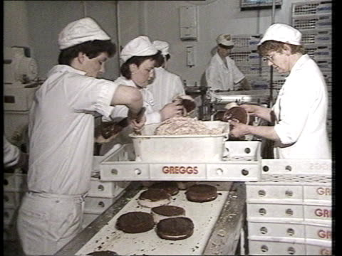 fat in food itn lib newcastle greggs bakery ms cream cakes being made ms coffee cream being put on ms icing poured over cakes - icing stock videos and b-roll footage