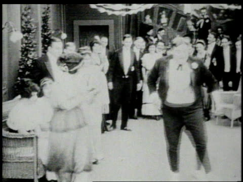 1914 b/w ws fat man (fatty arbuckle) dancing at a party  - 1914 stock videos & royalty-free footage