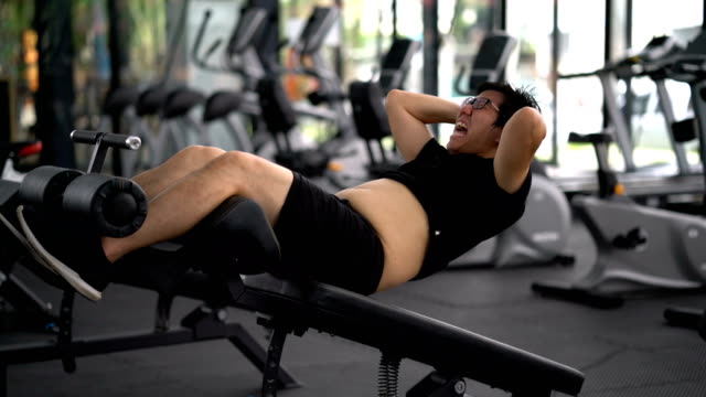 fat man doing sit ups at gym - washboard stock videos and b-roll footage