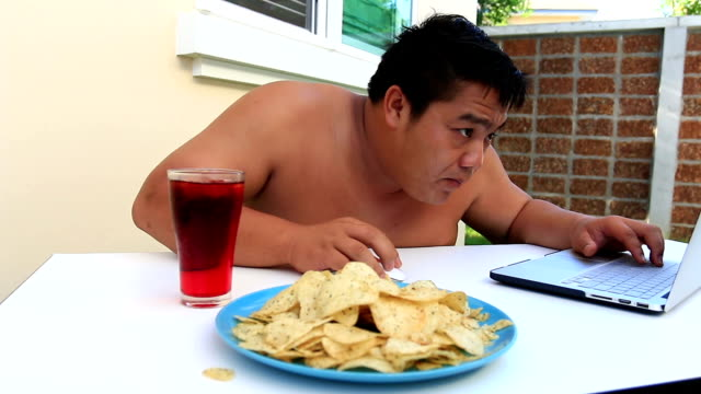 fat man eating - lubrication stock videos & royalty-free footage