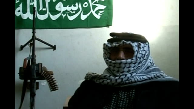 fatah al islam group in nahr al bared camp; *uk rights only, no international use* shaker al absi along between two masked gunmen int shaker al absi... - fighter stock videos & royalty-free footage