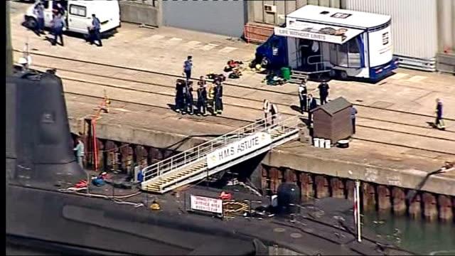 fatal shooting aboard royal navy nuclear submarine hms astute; england: hampshire: southampton: ext air view of royal navy nuclear submarine hms... - guarding stock videos & royalty-free footage