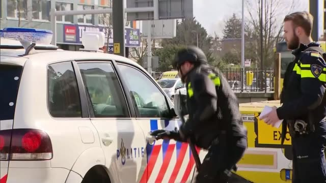 fatal shooting on tram in utrecht puts city on lockdown for several hours the netherlands randstad utrecht ext police officer knocking on car window - utrecht stock videos and b-roll footage