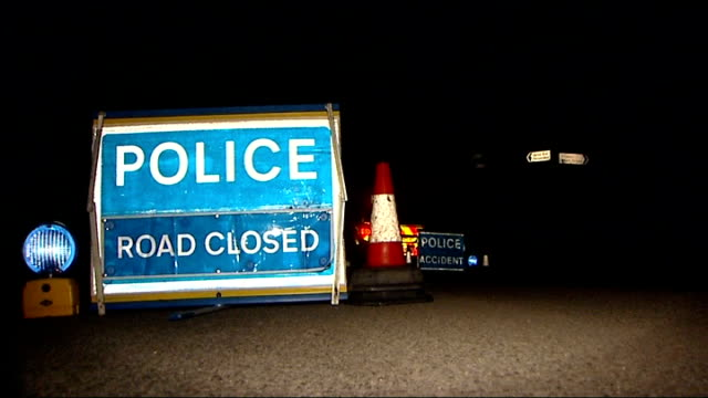 fatal stabbing in wheathampstead; england: hertfordshire: wheathampstead: ferrers lane: ext / night police vehicle and 'road closed' signs in lay-by... - road closed englisches verkehrsschild stock-videos und b-roll-filmmaterial
