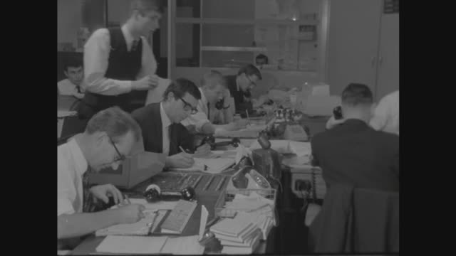 London Westminster Overseas Bank W various shots of foreign exchange traders at work at desks and talking on telephones in office Mr Batt interview...