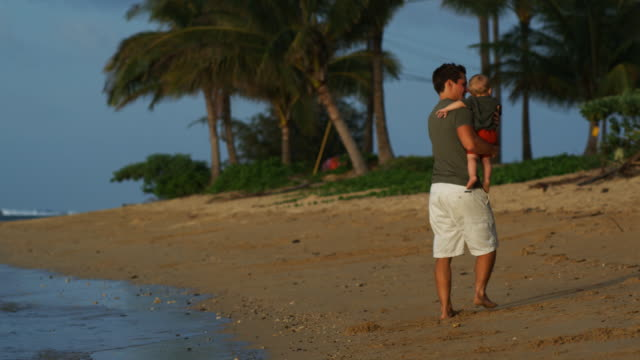 father and baby at the beach - genderblend video stock e b–roll