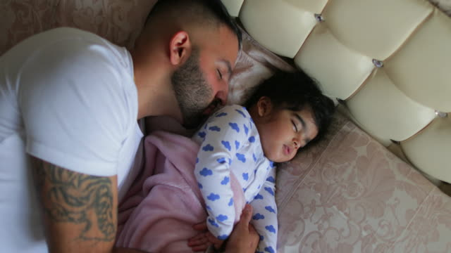 father and baby girl fast asleep - tutina video stock e b–roll