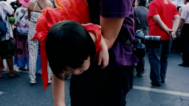 father and baby girl having fun in chinese new year festival - genderblend stock videos & royalty-free footage
