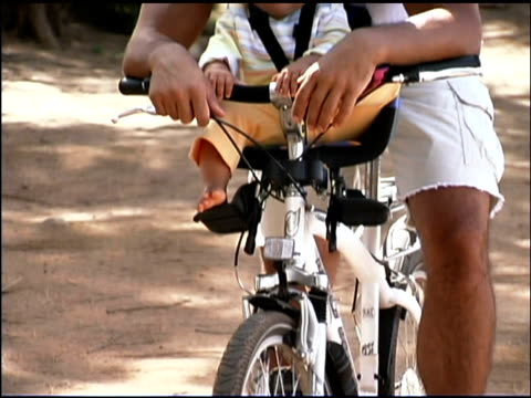 father and baby on bicycle - bicycle seat stock videos & royalty-free footage